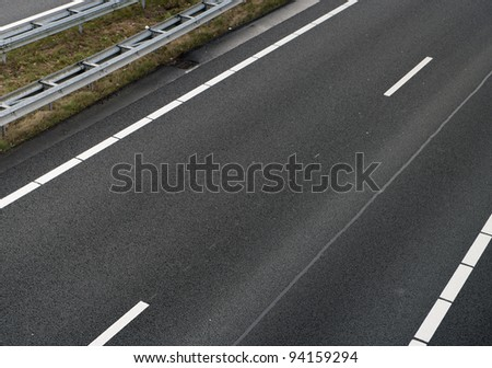 view from a bridge over a several lanes highway with porous asphalt - stock photo