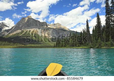 View from a canoe on mountain lake with green water (Emerald lake. Yoho National park. Alberta. Canada)