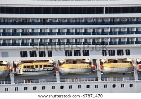 view from a cruise line ship side with lifeboats and balcony stateroom