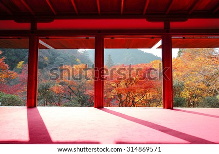 View from a Japanese tea ceremony room toward the autumn mountains with beautiful maple foliage in Kyoto, Japan - stock photo