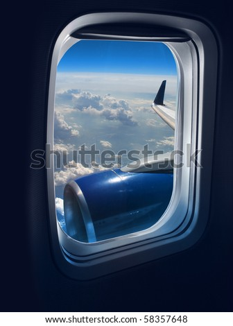 View from a jet plane window high on the blue skies - stock photo
