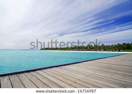 View from a jetty at a tropical island in the Maldives - stock photo