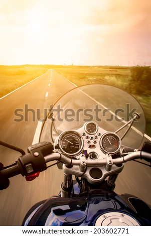 View from a motorcycle on road - stock photo