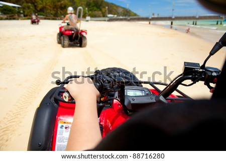 View from a quad bike on a beach - stock photo