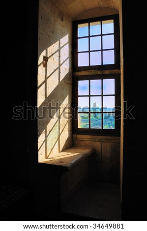 View from a stone window seat in the castle at Chateauneuf in Burgundy, France
