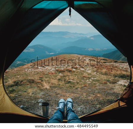 View from a tent in the mountains. Travel concept. Zen