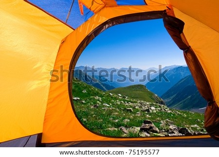 view from a touristic tent to a blue misty mountains - stock photo