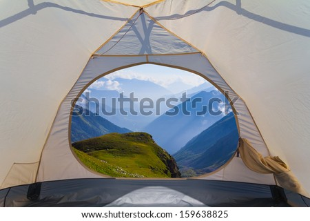 view from a touristic tent to a mountain valley - stock photo