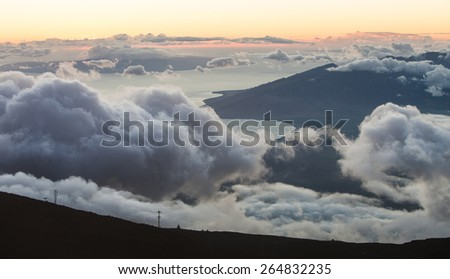 View from above clouds in Muai mountains - stock photo