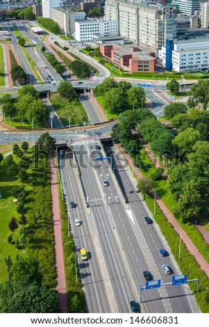 View from above of a large highway with roundabout in the Dutch city of Rotterdam - stock photo