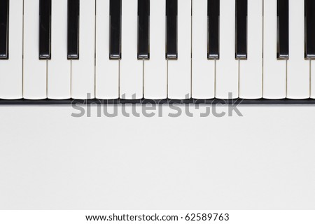 View from above of a piano keyboard on the upper half of frame. Copy space on the lower half - stock photo