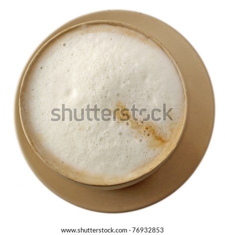View from above of cappuccino in a cup over a plate - stock photo