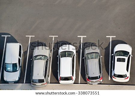 View from above of car parking full of vehicles. - stock photo