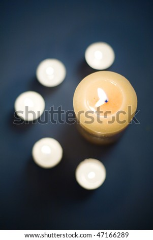 View from above of lit scented candles in studio. - stock photo
