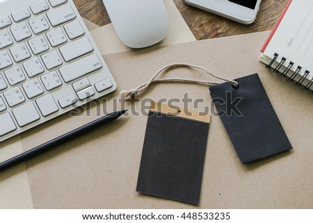 View from above of office supplies on a wooden working table background