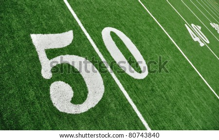 View From Above of 50 Yard Line on American Football Field With Artificial Turf - stock photo