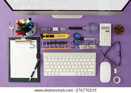 View from above on the well organized working space at the office with keyboard, computer mouse. Business and office supplies. - stock photo