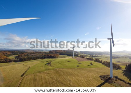 View from above over the countryside with wind turbines - stock photo