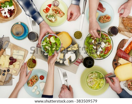 View from above the table of people eating - stock photo