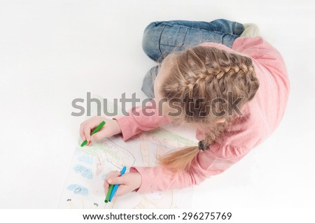 View from above to drawing little girl and her painting - stock photo