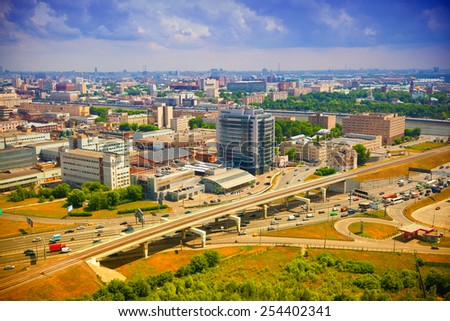 View from above to Moscow - roads, cars, modern architecture. Life of the big city - stock photo