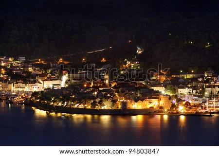 View from above to the ancient Korcula town in Croatia in the night - stock photo