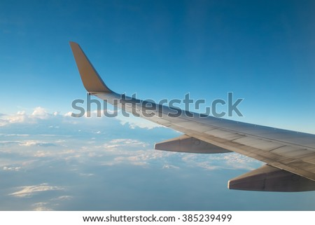 View from Airplane window fly over the Cumulonimbus cloud bird eye view in the evening ove Thailand