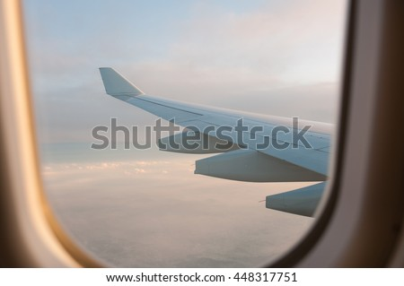 View from Airplane Window  Focus at airplane's wing