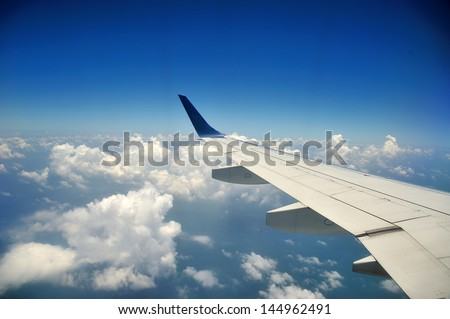 View from airplane with wing - stock photo