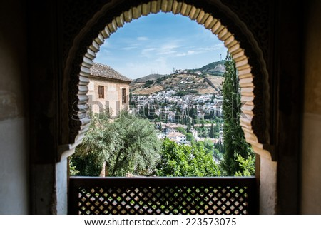 view from alhambra through the window - stock photo
