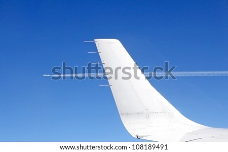 View from an aircraft window on a parallel plane - stock photo