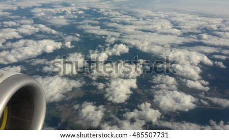 view from an airplane  cloudy sky