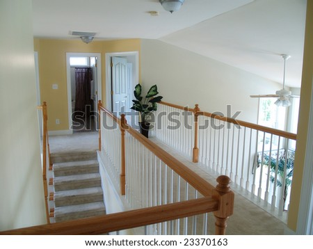 View from an interior balcony of the landing overlooking the family room - stock photo