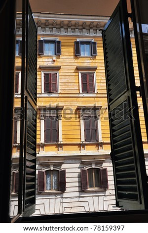 View from an Italian apartment window in apartments building in Rome, Italy - stock photo