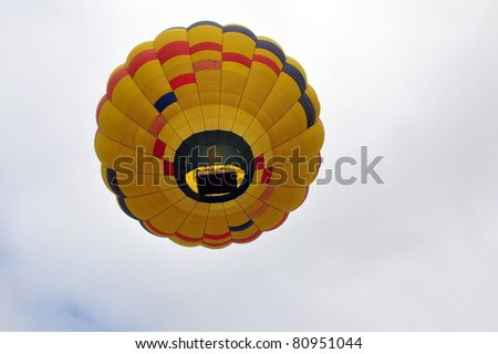 View from below of hot air balloon floating in the sky - stock photo