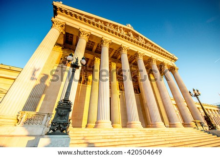 View from below on Austrian parliament building in Vienna on the sunrise - stock photo