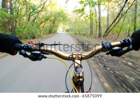 View from bikers eyes. motion blurred. - stock photo