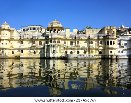 view from boat on lake and palaces in Udaipur India  - stock photo