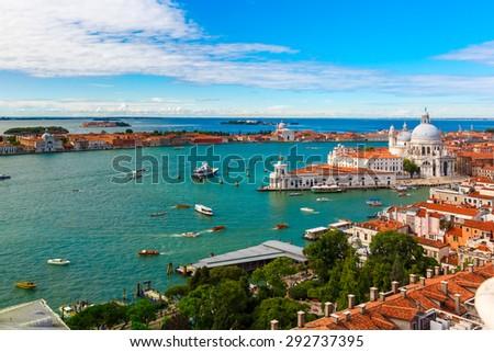 View from Campanile di San Marco to Basilica di Santa Maria della Salute, Dogana di Mare and Giudecca island at summer morning in Venice, Italy - stock photo