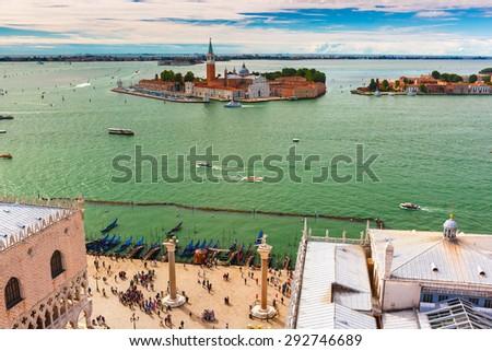 View from Campanile di San Marco to Piazzetta di San Marco with two granite columns and San Giorgio Maggiore island at summer morning in Venice, Italy - stock photo