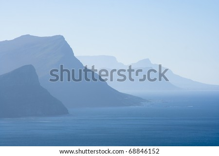 View from Cape of Good Hoop. In the late afternoon the mountains and ocean blend in a blueish atmosphere. - stock photo