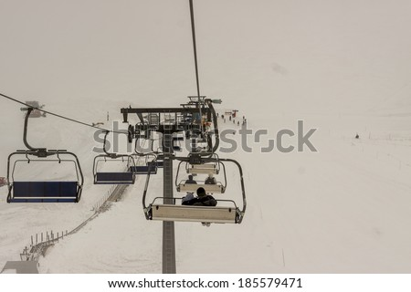 View from chair-lift, foggy day, Glacier 3000  Les Diablerets Swiss. - stock photo