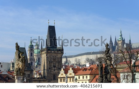 View from Charles Bridge toward Lesser Town towers, St. Nicholas Cathedral and St. Vitus Cathedral in Prague Castle with statues of St. Luthgard and St. Cajetan on foreground, Prague, Czech Republic. - stock photo