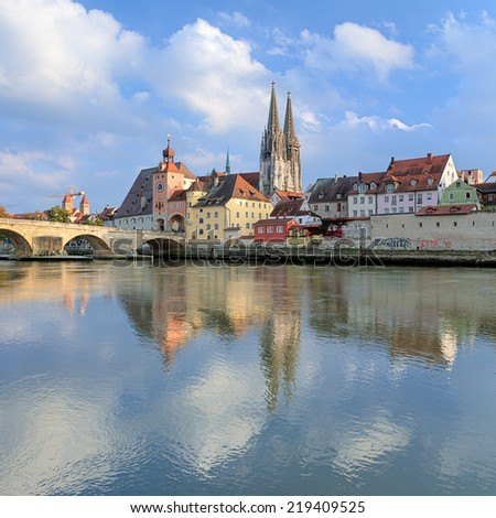View from Danube on Regensburg Cathedral and Stone Bridge in Regensburg, Germany - stock photo