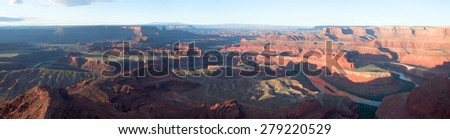 View from Dead Horse Point of the Colorado River at sunrise. Panorama  - stock photo