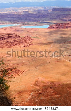 View from Dead horse state park into canyonlands and salt settling ponds