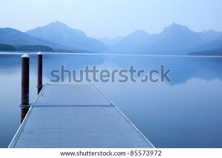 View from Dock on a Calm Serene Lake  (Lake McDonald, Glacier National Park) - stock photo