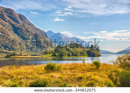 View from Glenfinnan Memorial over beautiful Loch Shiel and the Scottish Highlands next to it, HDR version - stock photo