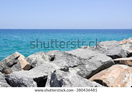 View from groyne at Cottesloe Beach of the turquoise Indian Ocean seascape in Western Australia/Indian Ocean Waters with Rocky Breakwater/Cottesloe Beach, Western Australia - stock photo