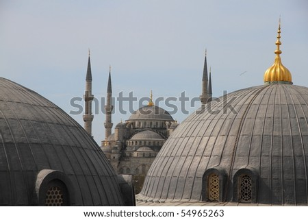 view from Hagia Sofia on over the roofs of the blue mosque in Istanbul Turkey - stock photo